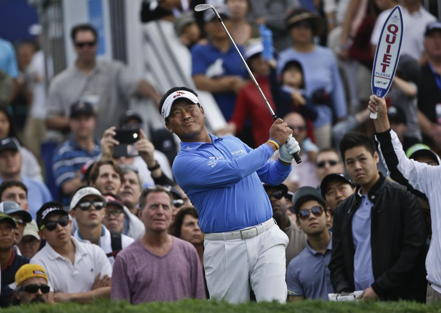 K.J. Choi looks skyward after hitting a high flop shot from the rough adjacent the 17th green on the South Course during the final round of the Farmers Insurance Open golf tournament Sunday, Jan. 26, 2014, in San Diego. Choi finished the tournament at 8-under-par. (AP Photo/Lenny Ignelzi)