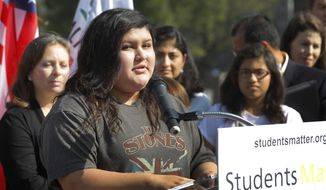 Raylene Monterroza takes questions from the media, as she is joined by eight other California public school students who are suing the state to abolish its laws on teacher tenure, seniority and other protections, during a news conference outside the Los Angeles Superior Court Monday, Jan. 27, 2014 in Los Angeles. Their case Vergara v. California is the latest battle in a growing nationwide challenge to union-backed protections for teachers. (AP Photo/Nick Ut)