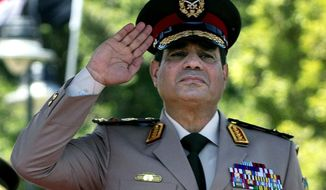 ** FILE ** In this Wednesday, April 24, 2013, file photo, Egyptian Defense Minister Gen. Abdel-Fattah el-Sissi salutes during an arrival ceremony for U.S. Secretary of Defense Chuck Hagel at the Ministry of Defense in Cairo. (AP Photo/Jim Watson, Pool, File)