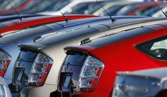 ** FILE ** In this Nov. 4, 2007, file photo, unsold 2008 Prius hybrid sedans sit on a lot at a Toyota dealership in the southeast Denver suburb of Centennial, Colo. (AP Photo/David Zalubowski, File)