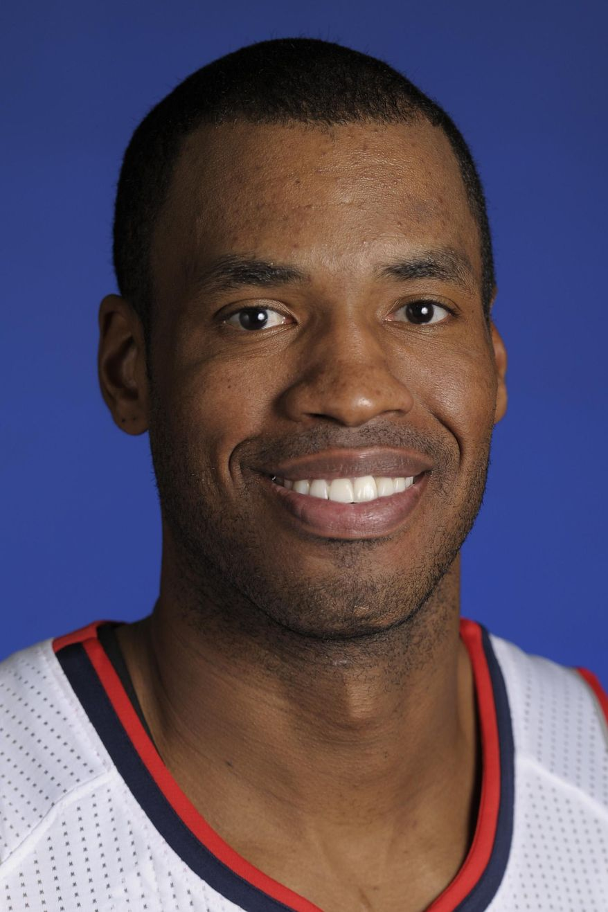 FILE - This Dec. 12, 2101 file photo shows then-Atlanta Hawks center Jason Collins during media day in Atlanta. Two survivors of the Boston Marathon bombing and an openly gay NBA player are among the guests who will sit with first lady Michelle Obama Tuesday when President Barack Obama delivers the annual State of the Union address.(AP Photo/John Amis, File)