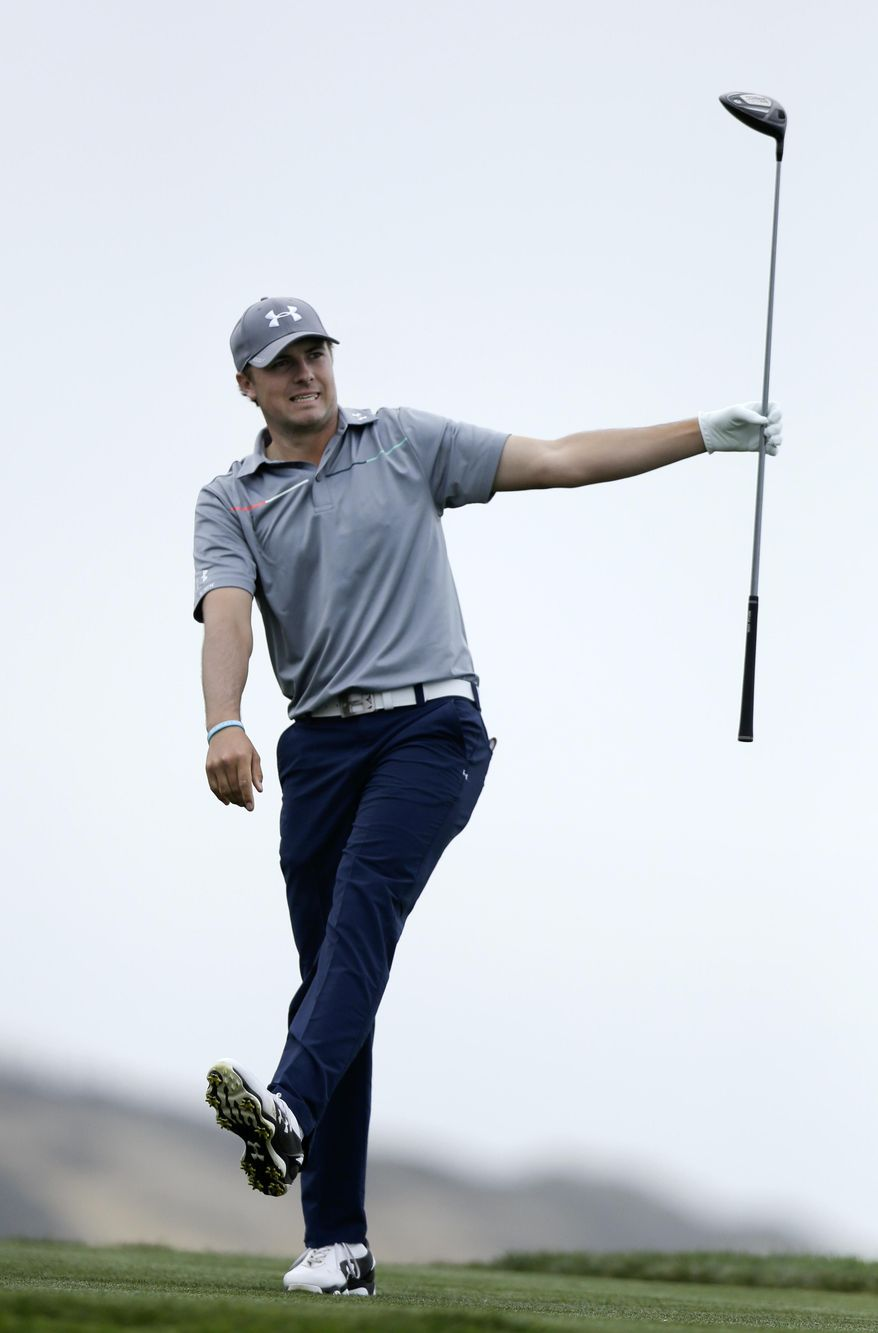 Jordan Spieth reacts as his tee shot flies to the left of the fairway on the fourth hole of the South Course at Torrey Pines during the final round of the Farmers Insurance Open golf tournament Sunday, Jan. 26, 2014, in San Diego. (AP Photo/Gregory Bull)