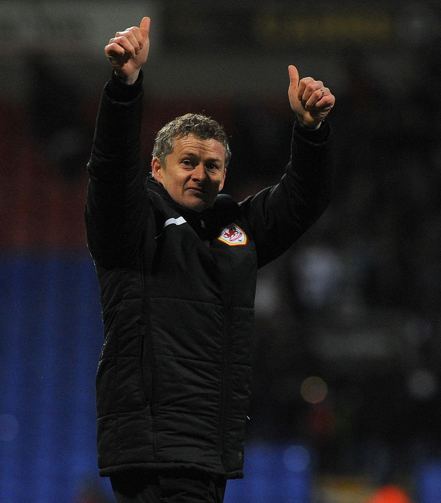 Cardiff City's Norwegian manager Ole Gunnar Solskjaer salutes the fans after their 1-0 win against Bolton Wanderers in their English FA Cup fourth round soccer match at the Reebok Stadium, Bolton, England, Saturday Jan. 25, 2014. (AP Photo/PA, Tom Yates) UNITED KINGDOM OUT  NO SALES  NO ARCHIVE