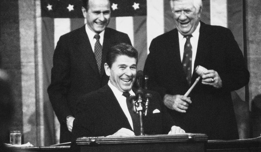 Ronald Reagan, receiving applause prior to making his State of the Union Address in 1983, and George H.W. Bush and George W. Bush led the pack of 44 presidents in terms of frequency of mentioning God in their address to Congress. (AP Photo/Bob Daugherty, File)