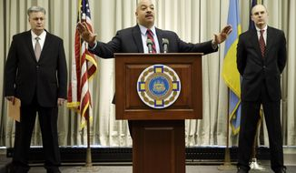 """Philadelphia District Attorney Seth Williams, center, accompanied by investigators Marc Costanzo, left, and Frank Fina, speaks during a news conference Monday, Jan. 27, 2014, in Philadelphia. Williams says first-term Democrat State Rep. Jose """"J.P."""" Miranda of Philadelphia and his sister have been charged in a ghost-worker plot involving his district office. The felony charges include perjury, criminal conspiracy and conflict of interest.  (AP Photo/Matt Rourke)"""