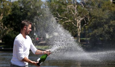 Switzerland's Stanislas Wawrinka sprays champagne as he celebrates his Australian Open men's singles final win over Spain's Rafael Nadal on Sunday evening in Melbourne, Australia, Monday, Jan. 27, 2014. (AP Photo/Aaron Favila)