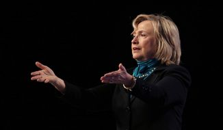 Former Secretary of State Hillary Rodham Clinton speaks to the National Automobile Dealers Association meeting in New Orleans, Monday, Jan. 27, 2014. (AP Photo/Gerald Herbert)