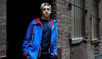 "This Oct. 4, 2013 photo shows Canadian Olympic snowboarder Mark McMorris posing for a photo in Toronto. McMorris is in ""great spirits,"" despite a fall that fractured a rib and nearly derailed his dream. (AP Photo/The Canadian Press, Nathan Denette)"