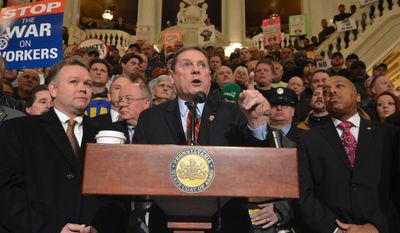 William Hamilton, the president of the Pennsylvania Conference of Teamsters, speaks at a rally in a packed Pennsylvania Capitol Rotunda as labor unions widened their fight against legislation to prevent the state and local governments from deducting union dues and union political action committee contributions from the paychecks of unionized workers, Tuesday, Jan. 28, 2014 in Harrisburg, Pa. (AP Photo/Marc Levy)
