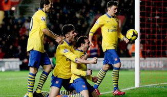 Arsenal's Santi Cazorla, third right, celebrates his goal with, from left, Mathieu Flamini, Olivier Giroud and Mesut Ozil during the English Premier League soccer match between Southampton and Arsenal at St Mary's stadium in Southampton, Tuesday, Jan. 28, 2014.  (AP Photo/Matt Dunham)