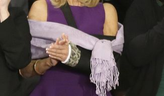 Jill Biden, wife of Vice President Joe Biden applauds during President Barack Obama's State of the Union address on Capitol Hill in Washington, Tuesday Jan. 28, 2014. Mrs. Biden's arm is in a cast after she broke her wrist after a fall. (AP Photo/J. Scott Applewhite)