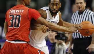 Kansas State forward Thomas Gipson (42) is covered by Texas Tech forward Jaye Crockett (30) during the first half of an NCAA college basketball game in Manhattan, Kan., Tuesday, Jan. 28, 2014. (AP Photo/Orlin Wagner)