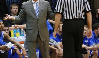 Kentucky coach John Calipari questions a referee during the first half of an NCAA college basketball game against LSU in Baton Rouge, La., Tuesday, Jan. 28, 2014. (AP Photo/Tim Mueller)