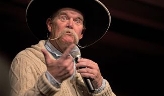 "Cowboy poet Waddie Mitchell makes a face while reciting a poem Monday, Jan. 27, 2014, during the ""Home Means Nevada"" show during the 30th National Cowboy Poetry Gathering at the G Three Bar Theater of of the Western Folklife Center in Elko, Nev. (AP Photo/Elko Daily Free Press, Ross Andreson)"