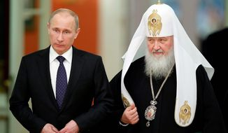 """side by side: Russian Orthodox Church Patriarch Kirill I has echoed President Vladimir Putin's view that Western countries are engaging in a """"spiritual disarmament"""" of their people. (Associated Press)"""