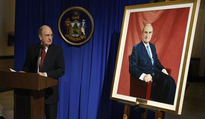 Former Sen. George Mitchell speaks after the unveiling of his portrait, Tuesday, Jan. 28, 2014, at the State House in Augusta, Maine.  The painting, by James Hanley, will hang in the Hall of Flags at the State House. (AP Photo/Robert F. Bukaty)