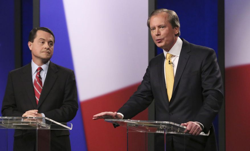 Republican Texas lieutenant governor candidates  Agricultural Commissioner Todd Staples looks on as  Lt. Gov. David Dewhurst speaks during a debate at KERA studios in Dallas, Monday, Jan. 27, 2014.  The four Republican candidates are vying to be Texas lieutenant governor, a post considered to be the most powerful in the state. (AP Photo/LM Otero,Pool)