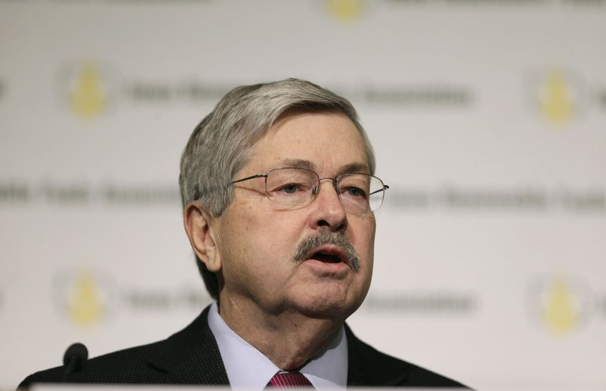 Iowa Gov. Terry Branstad speaks during the Iowa Renewable Fuels Association Summit, Tuesday, Jan. 28, 2014, in Altoona, Iowa. Branstad says he feels momentum is with Iowa and other farm states pushing the EPA to reverse a plan to cut the amount of biofuels blended into gasoline this year. (AP Photo/Charlie Neibergall)