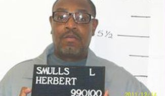 ** FILE ** In this Dec. 13, 2011, file photo released by the Missouri Department of Corrections is death-row inmate Herbert Smulls who is scheduled to die by injection one minute after midnight Wednesday, Jan. 29, 2014, for killing St. Louis County jeweler Stephen Honickman in 1991. Attorneys for Smulls are pressing on with concerns about Missouri's execution drug, even as the state prepares for its third execution since November. (AP Photo/Missouri Department of Corrections)