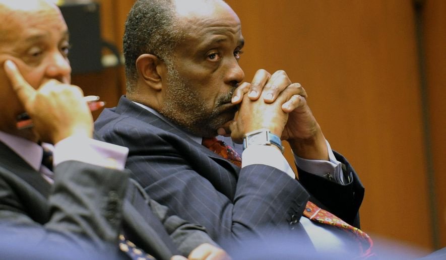 In this Thursday, Jan. 16, 2014, file photo, State Sen. Roderick Wright, D-Inglewood, right, listens during his perjury and voter fraud trial at Los Angeles Superior court. Roderick Wright has been convicted in a perjury and voter fraud case. A Los Angeles County Superior Court jury returned the verdict Tuesday, Jan. 28. 2014, on eight counts against the Democrat. Prosecutors said Wright sought to appear to have moved into an Inglewood property he owned in order to run in what at the time was the 25th Senate District but he actually lived outside the district. (AP Photo/The Daily Breeze, Stephen Carr, File) ** FILE **