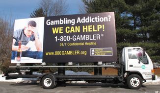 A mobile billboard for New jersey's Council on Compulsive Gambling sits in the group's Hamilton, N.J,. office parking lot on Tuesday Jan. 28, 2014.  The billboard will tour locations near MetLife Stadium in East Rutherford, N.J., where the Super Bowl will be played on Sunday. The billboard advertises a hotline for compulsive gamblers. (AP Photo/Wayne Parry)