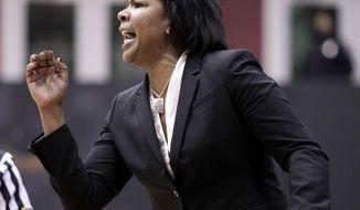 Temple coach Tonya Cardoza calls a play against Connecticut in the first half of an NCAA college basketball game, Tuesday, Jan. 28, 2014, in Philadelphia. Connecticut won 93-56.(AP Photo/H. Rumph Jr.)