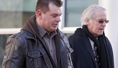 Eric Jensen, 37,  leaves the federal courthouse in Denver on Tuesday, Jan. 28, 2014, with attorney Forrest Lewis after he and his brother Ryan were sentenced to five years of probation and six months of home detention. The two Colorado cantaloupe farmers who pleaded guilty to misdemeanor charges stemming from a deadly listeria outbreak in 2011 were also ordered to each pay $150,000 in restitution and perform 100 hours of community service.(AP Photo/Ed Andrieski)