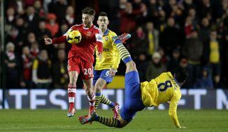 Southampton's Adam Lallana, left, competes for the ball with Arsenal's Mikel Arteta, right, during the English Premier League soccer match between Southampton and Arsenal at St Mary's stadium in Southampton, Tuesday, Jan. 28, 2014.  (AP Photo/Matt Dunham)