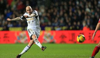 Swansea City's Jonjo Shelvey scores his side's first goal of the game during the English Premier League soccer match at the Liberty Stadium, Swansea, Wales, Tuesday, Jan. 28, 2014. (AP Photo/Nick Potts, PA Wire)   UNITED KINGDOM OUT   -  NO SALES  -  NO ARCHIVES