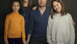 "In this Sunday, Jan. 19, 2014 photo, from left, actress Ashley Aufderheide, director Maya Forbes, actor Mark Ruffalo and actress Imogene Wolodarsky of the film, ""Infinitely Polar Bear,"" pose for a portrait at The Collective and Gibson Lounge Powered by CEG, during the Sundance Film Festival, in Park City, Utah. The film premiered at the 2014 Sundance Film Festival. (Photo by Victoria Will/Invision/AP)"