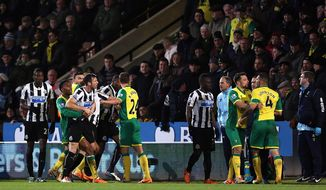 Norwich City's Bradley Johnson, right, and Newcastle United's Loic Remy, third left, are separated by their teammates after a scuffle during their English Premier League soccer match at Carrow Road, Norwich, England, Tuesday, Jan. 28, 2014. (AP Photo/Chris Radburn, PA Wire)   UNITED KINGDOM OUT  -  NO SALES  -  NO ARCHIVES