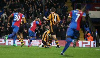 Crystal Palace's Jason Puncheon, second left, celebrates after scoring the opening goal during their English Premier League soccer match between  Crystal Palace and Hull City at Selhurst Park stadium in London Tuesday, Jan. 28, 2014.(AP Photo/Alastair Grant)