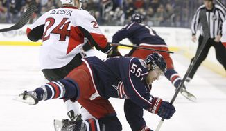 Columbus Blue Jackets' Mark Letestu (55) is upended by Ottawa Senators' Stephane Da Costa (24), of France, during the first period of an NHL hockey game, Tuesday, Jan. 28, 2014, in Columbus, Ohio. (AP Photo/Mike Munden)
