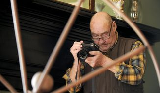 Ed Tillman, from Saint Louis, Mo., one of Photographer Tillman Crane's students, takes a picture at the Old State Bank building in Decatur, Al. Friday, January 24, 2014. Crane holds   photography workshops around the world. (AP Photo/The Decatur Daily, Jeronimo Nisa)