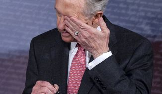 Senate Majority Leader Harry Reid wipes his eyes during a news conference on Capitol Hill in Washington, Friday, Sept. 23, 2011. (AP Photo/Harry Hamburg)