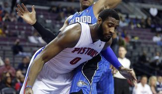 Detroit Pistons center Andre Drummond (0) drives to the basket against Orlando Magic forward Tobias Harris during the first half of an NBA basketball game Tuesday, Jan. 28, 2014, in Auburn Hills, Mich. (AP Photo/Duane Burleson)