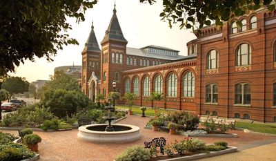 This undated photo provided by the Smithsonian Institution shows the Smithsonian Arts and Industries Building in Washington. Financial pressures have forced the Smithsonian Institution to rethink plans to reopen one of the oldest buildings on the National Mall this year as an innovation pavilion, leaving the site's future in question. The 133-year-old Arts and Industries Building, one of the original exhibition spaces in the nation's capital, has undergone a $55 million federally funded renovation to replace its roof and rehabilitate the structure. It was shuttered in 2004 because of structural problems and leaks. While scaffolding is now being dismantled around the building, it will remain closed until further notice, officials said late Monday. (AP Photo/Smithsonian Institution)