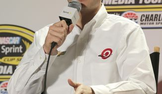 Kyle Larson, driver for Chip Ganassi Racing with Felix Sabates, speaks to the media during a news conference at the NASCAR Sprint Cup auto racing Media Tour in Charlotte, N.C., Tuesday, Jan. 28, 2014. (AP Photo/Chuck Burton)