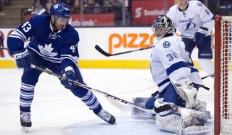 Toronto Maple Leafs' Nazem Kadri (43) scores his second goal of the game on Tampa Bay Lightning goaltender Ben Bishop during second period of an NHL game in Toronto, Tuesday, Jan. 28, 2014. (AP Photo/The Canadian Press, Frank Gunn)