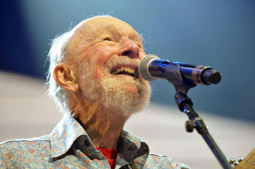 ** FILE ** This Sept. 21, 2013, file photo shows Pete Seeger performing on stage during the Farm Aid 2013 concert at Saratoga Performing Arts Center in Saratoga Springs, N.Y.  The American troubadour, folk singer and activist Seeger died Monday Jan. 27, 2014, at age 94.  (AP Photo/Hans Pennink, File)