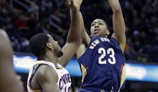 New Orleans Pelicans' Anthony Davis (23) shoots over Cleveland Cavaliers' Tristan Thompson (13), of Canada, during the first quarter of an NBA basketball game, Tuesday, Jan. 28, 2014, in Cleveland. (AP Photo/Tony Dejak)