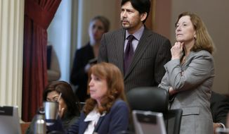 State Senators Kevin de Leon, D-Los Angeles,  Ellen Corbett, D-San Leandro, right, and Noreen Evans, D-Santa Rosa, seated, watch as the votes are tallied for de Leon's bill to require toy guns to look different from guns that fire bullets, during the Senate session at the Capitol in Sacramento, Calif., Tuesday, Jan. 28, 2014.  By a 22-8 vote the Senate approved the bill, SB199, that will require toy guns, BB guns, pellet guns and airsoft guns to be made to look clearly different from guns that fire bullets.  The bill was prompted by the fatal shooting of a 13-year-old boy in Santa Rosa by a Sonoma County Sheriff's deputy who mistook the boy's airsoft rifle for a real AK47 last October.  The bill now goes to the Assembly.(AP Photo/Rich Pedroncelli)
