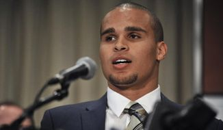 """Northwestern quarterback Kain Coulter speaks during a news conference in Chicago, Tuesday, Jan., 28, 2014. Calling the NCAA a """"dictatorship,"""" a handful of Northwestern football players announced Tuesday they are forming the first labor union for college athletes, the College Athletes Players Association. (AP Photo/Paul Beaty)"""