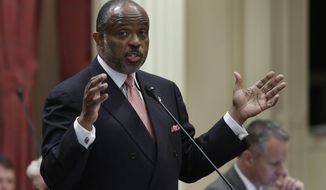 FILE -- In this Sept. 9, 2013 file photo is state Sen. Rod Wright, D-Inglewood,at the Capitol in Sacramento, Calif.  Wright was convicted of eight counts of perjury and voter fraud by a Los Angeles County Superior Court jury on Tuesday, Jan. 28, 2014.  Wright faces up to a  eight years and four months in prison when he is sentenced on March 12.(AP Photo/Rich Pedroncelli, file)