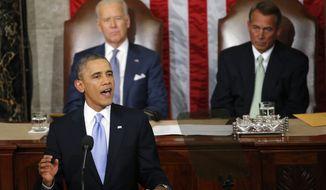 President Barack Obama gives his State of the Union address on Capitol Hill in Washington, Tuesday Jan. 28, 2014, as Vice President Joe Biden and House Speaker John Boehner of Ohio, listen. (AP Photo/Charles Dharapak)
