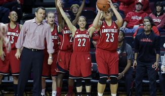The Louisville bench cheers as Shoni Schimmel (23) takes a shot during the second half of an NCAA college basketball game against  Rutgers Tuesday, Jan. 28, 2014, in Piscataway, N.J. Schimmel had 24 points in Louisville's 80-71 win. (AP Photo/Mel Evans)