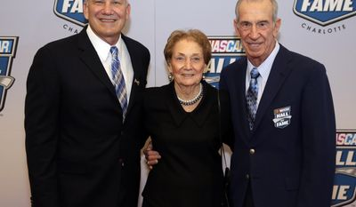 NASCAR Hall of Fame inductee Dale Jarrett, left, joins his father Ned, right, a Hall of Fame member, and his mom Martha, on the red carpet before the NASCAR Hall of Fame Induction Ceremony, Wednesday, Jan. 29, 2014, in Charlotte, N.C. (AP Photo/Bob Leverone)