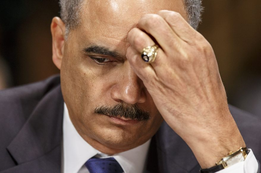 ** FILE ** Attorney General Eric Holder pauses while testifying on Capitol Hill in Washington, Wednesday, Jan. 29, 2014, before the Senate Judiciary Committee oversight hearing on the Justice Department. (AP Photo/J. Scott Applewhite)
