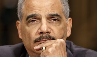 "HOLDING: ""All the options that we have are on the table,"" says Attorney General Eric H. Holder Jr., who insists his department's inquiry into the IRS is free from politics. (Associated Press)"