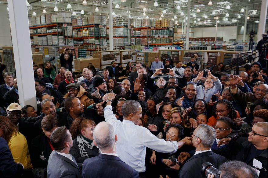 President Obama greets audience members at a Costco store in Lanham, Md., where he spoke about the need to raise the minimum wage. The president is promoting his newly unveiled plans to boost wages for some workers and help Americans save for retirement. (ASSOCIATED PRESS)